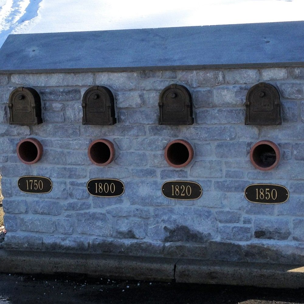 Four house mailbox out of limestone