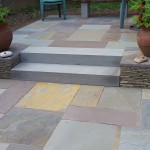 Full color bluestone patio with bluestone steps and thin colonial wall