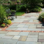 Full color bluestone patio with brick accent.