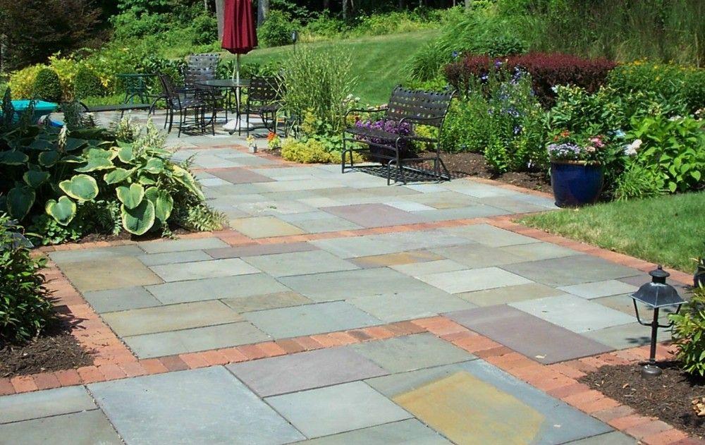Full color bluestone patio with brick accent.